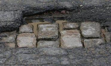 A cobblestone history is revealed on Berkeley Street in Boston.